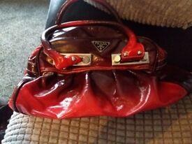 Red patent Prada bag
