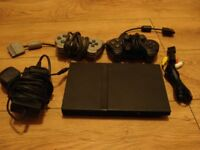Sony play station 2 slim in black with all leads and 2 x controllers.