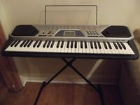 Casio CTK 481 Electric Keyboard with foldable stand.