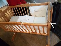 Pine crib with mattress and bedding