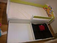 Unused children's bed with mattress