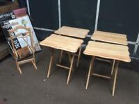 As new, four stackable, fold down table trays. Delivery available