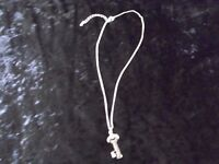 Glass key with diamante effect on chain