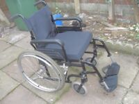 SELF PROPEL FOLDING WHEELCHAIR WITH CUSHION HAS WIDE 18-20 INCH SEAT VERY GOOD CONDITION