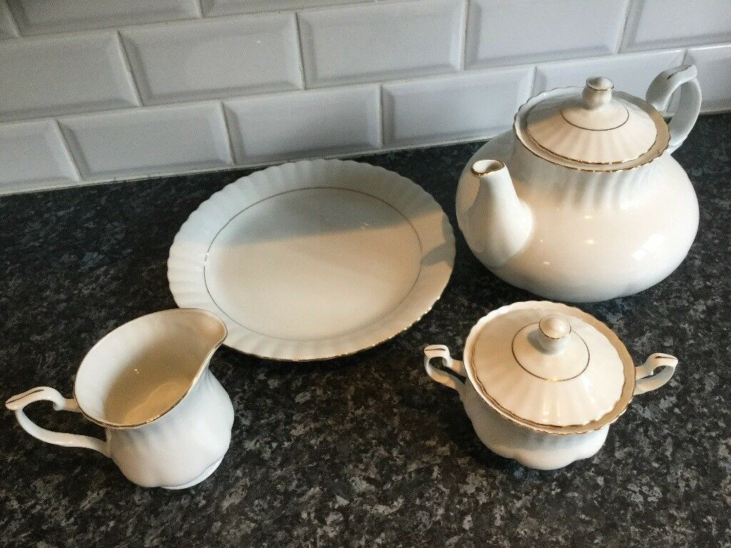 China matching tea pot,milk, sugar and plate with gold trim