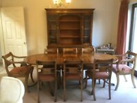 Dining table with eight chairs and sidebaord