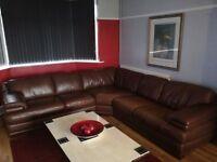 Leather corner suite.