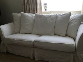 3 seater sofa with ivory coloured loose covers