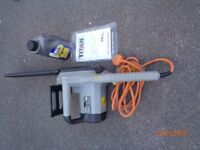 Titan electric chainsaw & oil