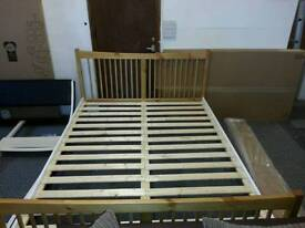A brand new two tone wooden king size bed frame.