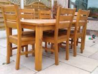 Solid pine dining table and six chairs stained in mid oak colour
