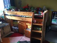 Child's bed with underneath desk and drawers