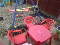 3 red kids outdoor chairs and tables