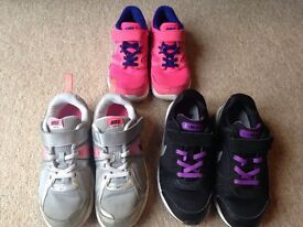3 pairs of size 1 Nike trainers