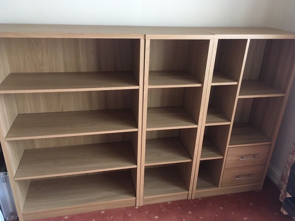 Book shelving and storage unit