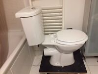 Unused Closed Coupled Toilet And Cistern