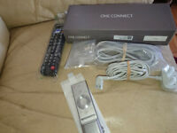 Samsung One connect box, smart remote with voice control, cables