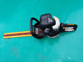 Petrol hedge trimmers and petrol grass strimmer