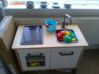 IKEA duktig play kitchen and steel pans. Play food also included. Good condition.
