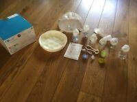 Mothercare microwave bottle steriliser with 6 bottles