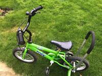 Kids green bike with stabilisers