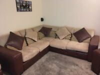 Immaculate beige suede and brown leather corner sofa.