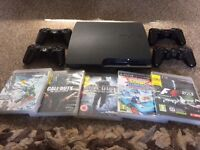Slim PS3 with 5 games 4 controllers