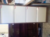 Used Bisley metal filing cabinet with 4 drawers, includes key.