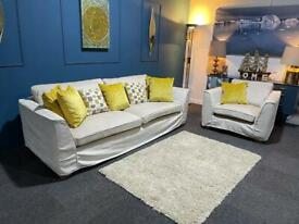 Large cream suite. 4 seater sofa and chair