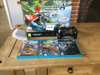Wii u with 3 games and extra controller
