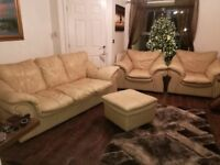 Buttermilk 3 piece leather suite. Includes 2 x Armchairs, 1 x 3 seater sofa plus foot stool