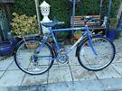 mans blue vintage 21 inch frame main street bike with lock