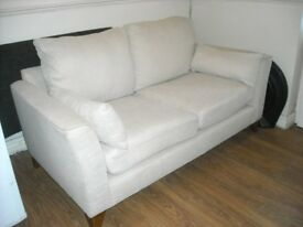 Georgeous Cream fabric 2 seater sofa. Mint condition.