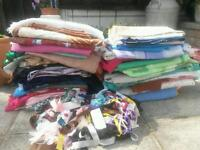 Large quantity of various fabric and a pile of ribbon etc.