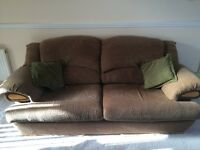 For sale a brown patterned 3 seater sofa and arm chair