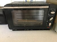 Small Used little black electric oven