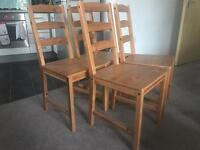 4 Ikea dining chairs with cream seat cushions