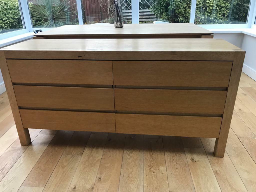 A solid oak chest is of draws