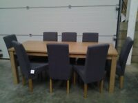 New 8 Fabric chairs, charcoal grey and FREE extend dining table. Can deliver. Bargain.