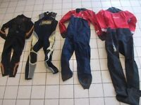 Collection of Wet Suits and Life Jackets