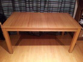 Modern extending dining table