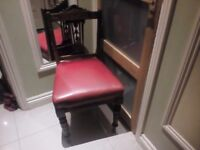 Vintage wooden and red foux leather chair in good condition