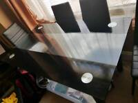 Glass table with 6 faux leather chairs