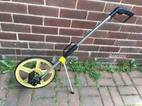 Rolson Measuring Wheel. Good Condition. Metric. Fold Down Handle. With Stand