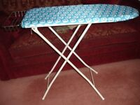 Used ironing board with brand new cover - 3 different height settings - removeble rack for iron