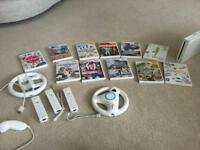 Wii plus 11 games controllers and steering wheel