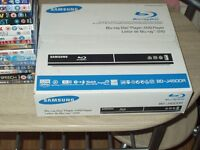 SAMSUNG BLU-RAY PLAYER WITH 18 BLU-RAYS ALL NEW AND SEALED