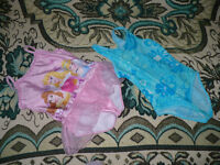 2x girls swimming costumes for 5-6 years, hardly used.