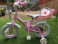 Apollo girls pink cupcake bike for sale in excellent condition, never used