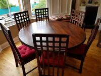 Large solid wood round dining table & 6 chairs